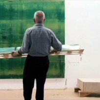 A short video showing Gerhard Richter creating a large painting
