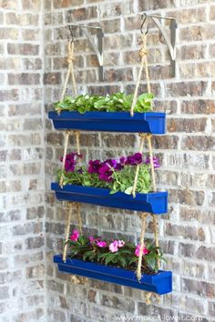 Hanging Rain Gutter Planters 25 Creative DIY Spring Porch Decorating Ideas – It's All About Repurposing!