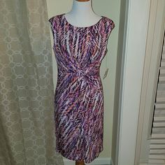 """Anne Klein coral and purple multi dress! Absolutely  stunning coral multi Knot wrap in the front Size 8 dress is 95% polyester 5% elastane Fully lined and lining is 100% polyester   Bust 17"""" Waist 15"""" Length  38""""  No trade No modeling Anne Klein Dresses"""