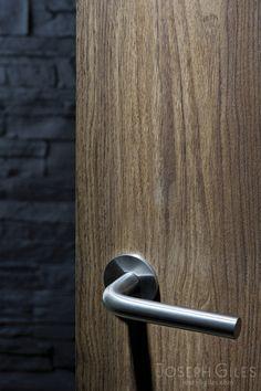 Joseph Giles Minimalist Stainless Steel Lever Handle on Walnut Door