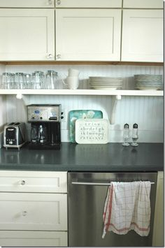 small shelf under cabinets for items that sit on counter but move shelf down 4 inches up from counter and make it a floating shelf.
