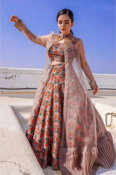 indian designer wear Cream Pink Colour Taffeta Silk Fabric Party Wear Lehenga Choli Comes With Matching Blouse. This Lehenga Choli Is Crafted With Embroidery. This Lehenga Choli Co Indian Gowns Dresses, Indian Fashion Dresses, Indian Designer Outfits, Indian Outfits, Indian Fashion Trends, Prom Dresses, Jacket Lehenga, Lehenga Suit, Lehnga Dress