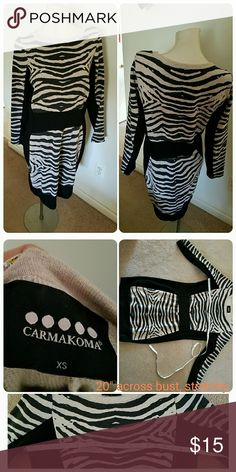 """Zebra Bodycon Dress Cute, sweatshirt weight dress with form-fitting Bodycon style. Zebra fabric is a Heathered off off white, and black panels are a smoother, stretchy fabric. Looks great with boots! Best for an hourglass figure. Plus size xs fits size 12, according to Carmakoma size chart, but it stretches to fit me comfortably at size 16. I would go by bust size, which measures 20"""" across. Worn once, like new condition. Carmakoma Dresses"""