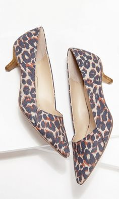 Leopard print kitten heel pump with a pointed toe and stacked heel