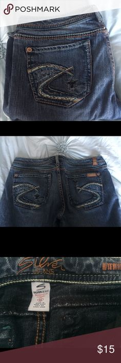 """Silver Jeans- Short Inseam Medium denim jeans with a little destruction, just the right amount to give them character. Measurements are 29"""" waist and 27"""" inseam. Boot cut and Kind of a western fit. These are my daughters and we had them """"French hemmed"""" to this inseam because she is 5'3"""". French hemming is a professional hem where the original hem is preserved, the length is just shortened. All of my items are from a non smoking, non cat environment and are firmly priced for one item. Silver…"""