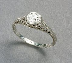 1920s ring  (When I saw this I had to post that I have a gold band with Blue Zircon stone! What are the chances?)