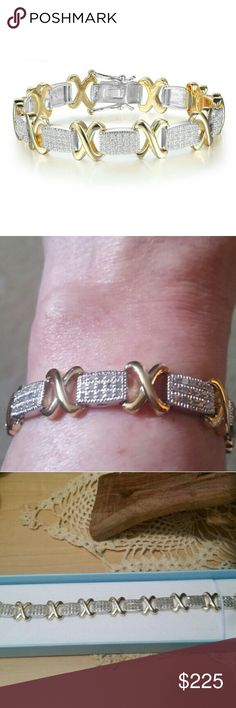 Classic Diamond Tennis Bracelet This elegant bracelet is brand new without tags. It features 104 sparkling diamonds, clarity @1.04 carats total. Bracelet is 7 inches long, and has a tongue and safty clasp for closure. Its crafted in yelliw gold over brass. Its very nice, and diamonds are real. SuperJeweler Jewelry Bracelets