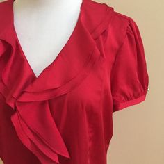 """Top ⭐️Beautiful red top with Ruffles down the front  and gold buttons⭐️In good condition⭐️Approximate measurements lying flat are: Length 21"""", Waist 16"""" & Bust 16 1/2""""⭐️97% Polyester & 3% Spandex⭐️Dry Clean⭐️No TradesNo PayPal Alex Marie Tops Blouses"""