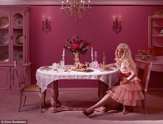 Sad: Eventually, Barbie is left alone at the dinner table, waiting for her famous partner to join her