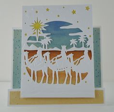 Lori Williams Designing for @CraftersCompUS Christmas Create a Card /CAC Die August Release  Die'sire Create-A-Card We Three Kings.   Nordic Christmas -Scandinavian Village 6 x6 Embossing Folder, Spectrum Noir Markers: CF1, TN1, TN3, TN7, TB3, TB4, TB1, Gold Dust Shimmering Card Stock 8 x 8