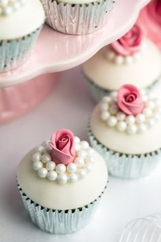 Rose cupcake idea - white frosted cupcakes with rose and pearl detail {Valerie & Valerie}