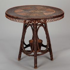 Circa French Round Table Made With Bent Willow And Twigs Featuring A Table  Top Star Inlay In Contrasting Light And Dark Woods.