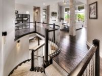 Staircase and hearth room of this contemporary modern floor plan with stone columns and dark hardwood floors Hardwood Floors, Flooring, Dark Hardwood, Laguna Hills, Modern Floor Plans, Stone Columns, Plan Design, Home Builders, Custom Homes