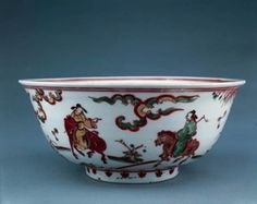 Porcelain bowl with rounded sides and everted rim, with a slightly tapered footring deeply undercut inside. Overglaze red, green, yellow, purplish brown and turquoise enamels. Man on a flowery bank with a waterfall within a double circle on inside centre; three men on horseback and a boy servant heading towards a pavillion amid stars and clouds on exterior. Mark on base in overglaze red. (Ming dynasty)