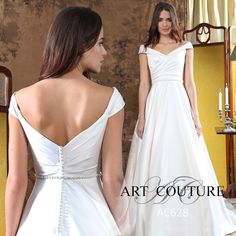 This beautiful Aline satin wedding dress boasts an elegant bardot neckline, button back and is accentuated on the waist with a delicate beaded belt.