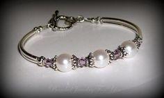 White Pearls and Amethyst Bracelet: Pearl Bracelet, Amethyst Jewelry, Pearl Jewelry, Bridal Party Bracelet, Wedding Jewelry, Crystal Jewelry by beadedjewelryforyou on Etsy https://www.etsy.com/listing/50706309/white-pearls-and-amethyst-bracelet-pearl