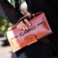 Must have this boho leather clutch!