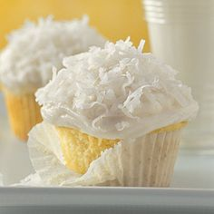 Coconut Cupcakes - Dress up basic white cupcakes with a Coconut Buttercream and sweetened flaked coconut. So simple, but so delicious too!
