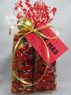 "2 Twix bars are wrapped up with a Lindor mint and a tag that reads, ""Merry TWIXmas to you!"" pioneerpartyandgift.com"