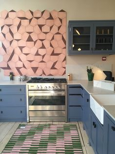 Our new kitchen in our London Showroom. Featuring Case Tiles in Guava/Maroon from Design, handles from Noble Grey worktop from Kitchen Decor, Kitchen Decor Grey, Kitchen, Modern Kitchen Photos, Kitchen Design, Kitchen Remodel, Kitchen Renovation, Best Kitchen Designs, Kitchen Projects