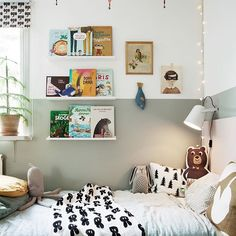 wall ledges are always a good idea in a kids room - wall art and storage!  #kidsroom #wallart #bookshelf