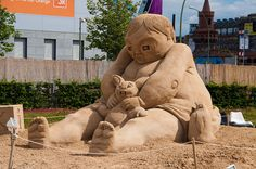 "Sand sculpture by Danish artist Patrick Steptoe called ""he's so cute""."