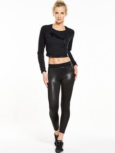 Puma Glossy Legging - Black Puma is giving its capsule pieces a glossy make over this season! Look to these leggings as proof! A stretchy waistband and form-fitting silhouette maintain the sporty appeal of this wardrobe essential, while a leather-look construction provides a seriously edgy twist!Team with a slouchy Puma sweater to nail laid back street style this weekend.Washing Instructions: Machine Washable