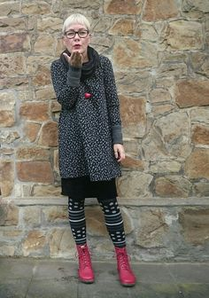 I love the comfy, casual, yet funky look of this outfit.  The red shoes.