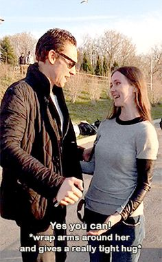 Oh, I LIKE hugs like this one! Tom Hiddleston, hugging a fan while in Canada filming Crimson Peak (?) She asked, and this was his response.<<<The foot pop! It was a foot popping hug. I would do the same.