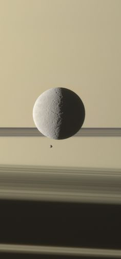 New Cassini Image: Saturn's moon Rhea with the planet's tiny moon Epimetheus. NASA/JPL-Caltech/Space Science Institute; processed image by G. Ugarković.