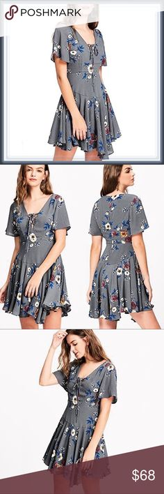 Plunge V neck Floral Flare Asymmetrical dress ➖SIZE: Medium ➖STYLE: A gray fit and flare dress with an unique Asymmetrical Hem and a plunging v lace up neckline.   ❌NO TRADE   325809 a lined sexy club Dresses Asymmetrical