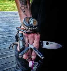 Balancing life and keeping it real. Digging the knife tattoo and pacifier :)