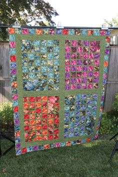 If you like unique quilts, this beauty is for you! This quilt features four different window views of beautiful floral fabrics in lovely colors. It is almost as if you are gazing out a window at a field of flowers.