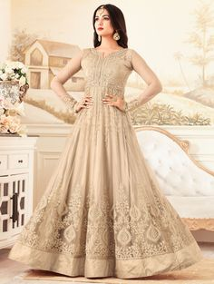Buy sonal chauhan net beige party wear anarkali 4607 online in USA, UK and Canada from KollyBollyEthnnics.com