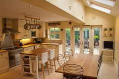 There are elements of this kitchen that I really like such as the windows, pans hanging from the ceiling, lighting etc.