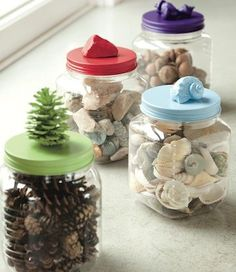 Here's a great idea for how to display the shells, the beach glass, the interesting stones that your kids fill up their pockets with. Just glue one of the objects to the top of a glass or plastic food jar (use a strong adhesive like Amazing Goop). When the glue is dry, paint the lid and the attached item a pretty color.
