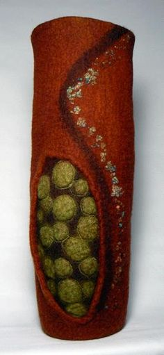 Jill Lynn is a felter who creates wearables, hats, wall arts, and vessels like this one using wet-felting techniques that she has taught here.