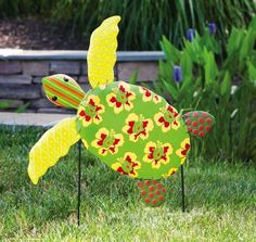 "Calypso Sea Turtle Garden Stake by Accent Your Life. $26.24. Hand painted. Approximate dimensions are 20"" x 3.5"" x 18"". Made of metal. Easily stakes into the ground. Add a bit of coastal flair to your yard or garden with this metal garden stake. Featuring a sea turtle adorned with hibiscus flowers, this garden stake will catch the eye of all who see it in your yard.. Save 46% Off!"