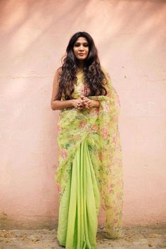 Green floral saree brings in the spring flair.