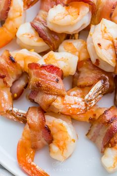 Tender shrimp wrapped in bacon, baked in the oven until crispy. Tossed with a sweet and maple butter glaze, great for an appetizer or main course. Quick And Easy Appetizers, Easy Appetizer Recipes, Healthy Appetizers, Best Paleo Recipes, Whole Food Recipes, Favorite Recipes, Bacon Wrapped Shrimp, Healthiest Seafood, Food For A Crowd
