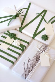 pretty gift wrapping idea  I like this idea to match a theme and a fun way to play with the ribbon.