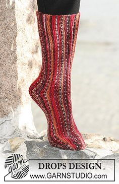 """DROPS by DROPS Design """"Why not knit the fall's coolest socks?"""" DROPS socks knitted in garter sts sideways with """"Fabel"""". Crochet Socks, Knitted Slippers, Knitting Socks, Loom Knitting, Hand Knitting, Knit Crochet, Crochet Granny, Drops Design, Two Needle Socks"""