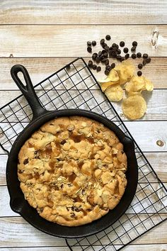 Sweet and salty potato chip and chocolate chip cookie made in a cast iron skillet. The perfect combination of salty and sweet with a little bit of crunch make this quick and easy cookie recipe a winner at our house! #dessertrecipes #cookie