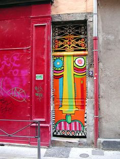 Brightly colored door with face. France