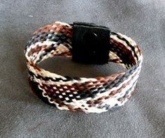 Tara's Equine Designs - Horsehair Jewelry  Wide band bracelet with leather and snap ends.