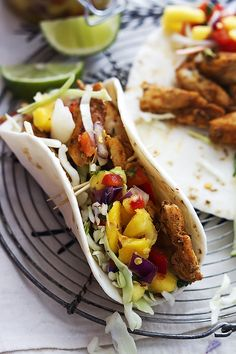 Incredibly tasty Caribbean chicken tacos topped with a quick and easy Caribbean salsa featuring mango, pineapple, red onions, and cilantro! Healthy & quick!