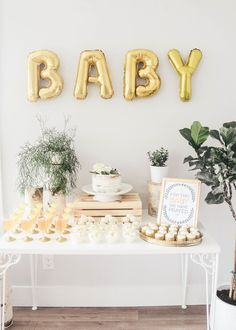 Need baby shower inspiration? This gorgeous Oh Baby theme set up is perfect! We love pairing metallic golds with greenery for the most effective baby shower set up! Décoration Baby Shower, Gateau Baby Shower, Bebe Shower, Fiesta Baby Shower, Simple Baby Shower, Gold Baby Showers, Gender Neutral Baby Shower, Shower Party, Baby Shower Parties