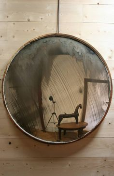 A huge and fantastic early C20th convex mirror