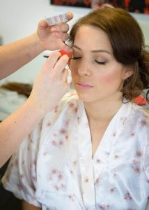 Beautiful bride Eloise getting some make up done