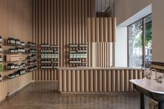 Brooks + Scarpa recycles cardboard tubes and paper for Los Angeles Aesop store interior